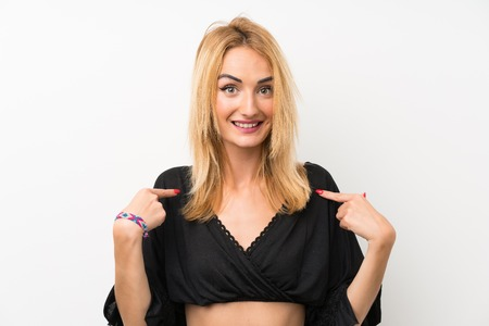 Young blonde woman over isolated white wall with surprise facial expression
