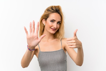 Young blonde woman over isolated white counting six with fingers Banco de Imagens