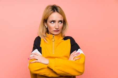 Young blonde woman over isolated pink background portrait Stockfoto