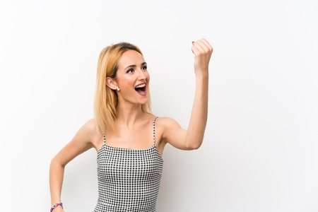 Young blonde woman over isolated white celebrating a victory Stock Photo