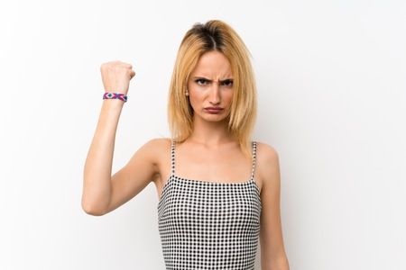 Young blonde woman over isolated white with angry gesture Stock fotó