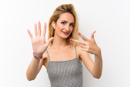 Young blonde woman over isolated white counting eight with fingers