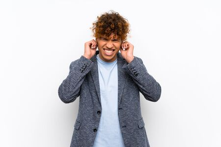 Fashion african american man over isolated white wall frustrated and covering ears