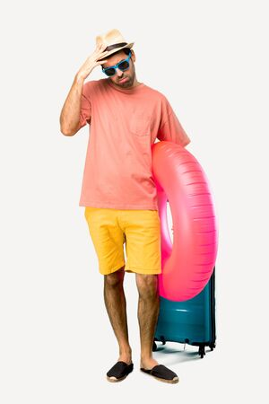 A full-length shot of Man with hat and sunglasses on his summer vacation unhappy and frustrated with something. Negative facial expression on isolated background Imagens