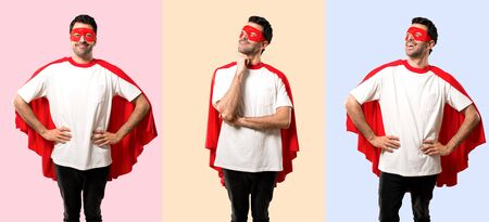 Set of Superhero man with mask and red cape standing and thinking an idea while looking up on colorful background Banco de Imagens