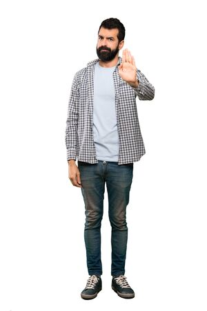 Handsome man with beard making stop gesture over isolated white background 스톡 콘텐츠 - 124924923