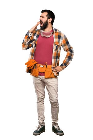 Craftsmen man yawning and covering wide open mouth with hand over isolated white background Imagens - 124924953