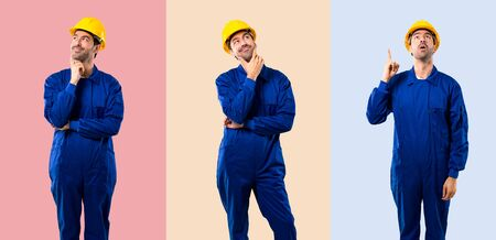 Set of Young workman with helmet standing and thinking an idea on colorful background