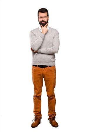 Handsome man thinking over isolated white background Zdjęcie Seryjne
