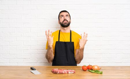 Chef holding in a cuisine frustrated by a bad situation