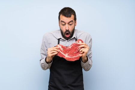 Chef holding a raw meat