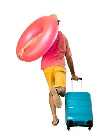 Full body of Man with hat and sunglasses on his summer vacation running fast on isolated background