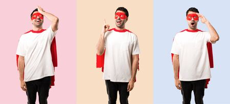 Set of Superhero man with mask and red cape intending to realizes the solution on colorful background Imagens
