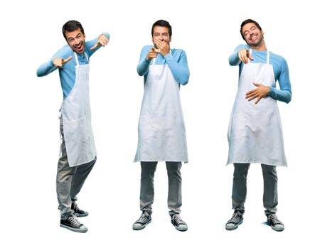Set of Man wearing an apron pointing with finger at someone and laughing a lot and pointing front