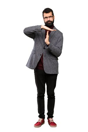 Handsome man with glasses making time out gesture over isolated white background 스톡 콘텐츠