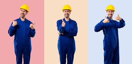 Set of Young workman with helmet giving a thumbs up gesture and smiling because something good has happened on colorful background Imagens