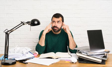 Student man having doubts and thinking Stock Photo - 124836941
