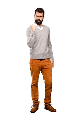 Handsome man with angry gesture over isolated white background Stock Photo