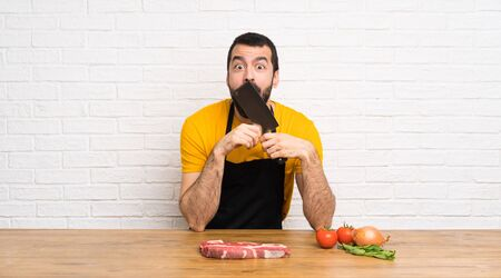 Chef in a cuisine covering his mouth