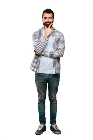 Handsome man with beard thinking over isolated white background