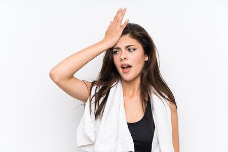 Teenager sport girl over isolated white background having doubts with confuse face expression