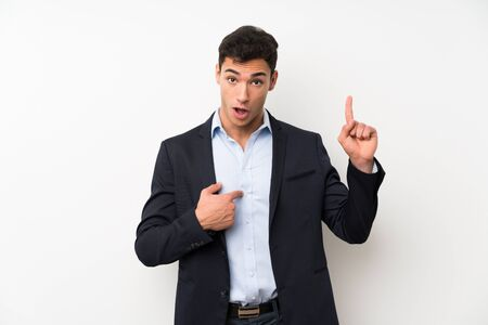 Handsome man over isolated white wall with surprise facial expression