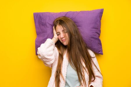 Young woman in dressing gown in a bed stressed