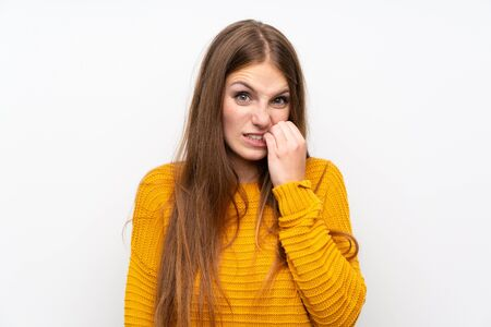 Young woman with yellow over isolated white wall nervous and scared