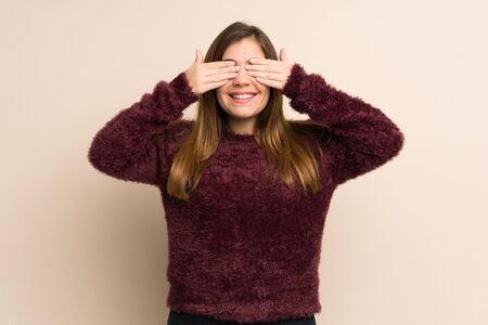 Young girl covering eyes by hands