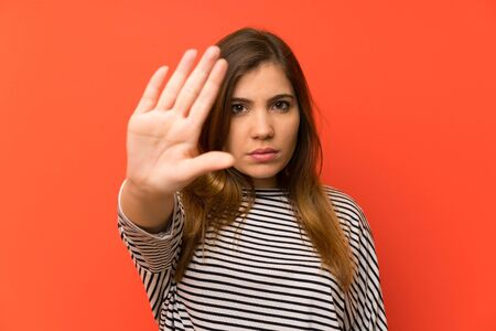 Young girl with striped shirt making stop gesture with her hand Stock fotó