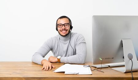 Telemarketer Colombian man with glasses and happy
