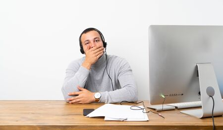 Telemarketer Colombian man covering mouth with hands Banco de Imagens