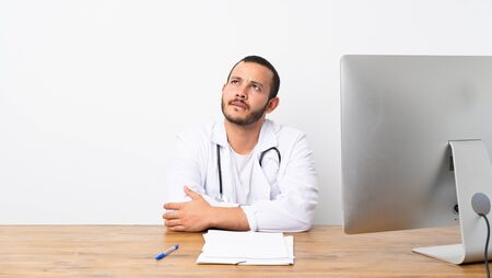 Doctor Colombian man with confuse face expression