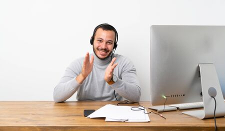 Telemarketer Colombian man applauding after presentation in a conference