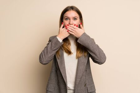 Young business woman covering mouth with hands