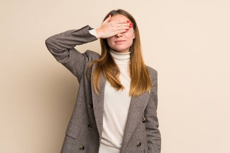 Young business woman covering eyes by hands. Do not want to see something