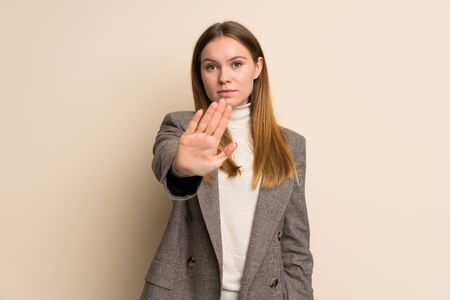Young business woman making stop gesture