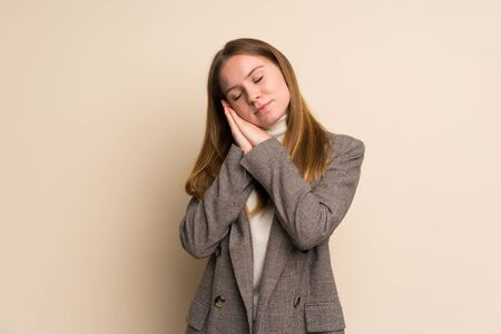 Young business woman making sleep gesture in dorable expression