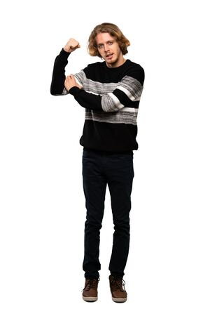 Full-length shot of Blonde man doing strong gesture over isolated white background