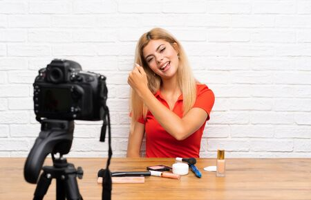 Teenager blogger girl recording a video tutorial celebrating a victory
