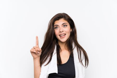 Teenager sport girl over isolated white background pointing with the index finger a great idea Banque d'images - 129065473