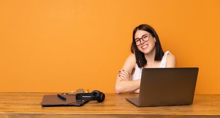 Business woman in a office looking up while smiling