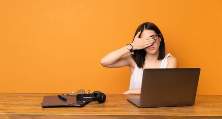 Business woman in a office covering eyes by hands. Do not want to see something Фото со стока