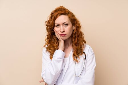 Redhead doctor woman unhappy and frustrated