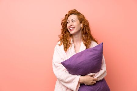 Redhead woman in dressing gown laughing
