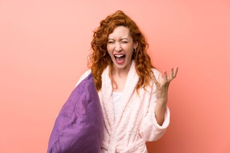 Redhead woman in dressing gown unhappy and frustrated with something