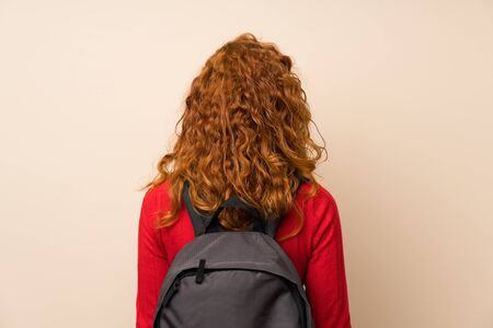 Redhead woman with turtleneck sweater with backpack