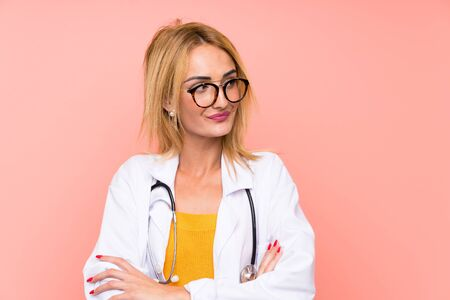 Young blonde doctor woman thinking an idea 写真素材