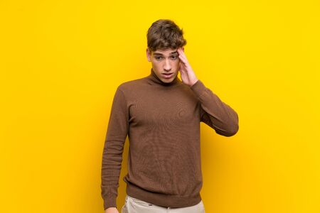 Handsome young man over isolated yellow background has just realized something and has intending the solution