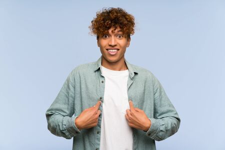Young african american man over isolated blue wall with surprise facial expression